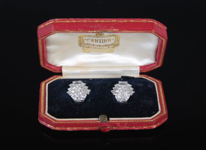 A pair of early 20th century Art Deco white metal and diamond earrings by Cartier, sold for £8300