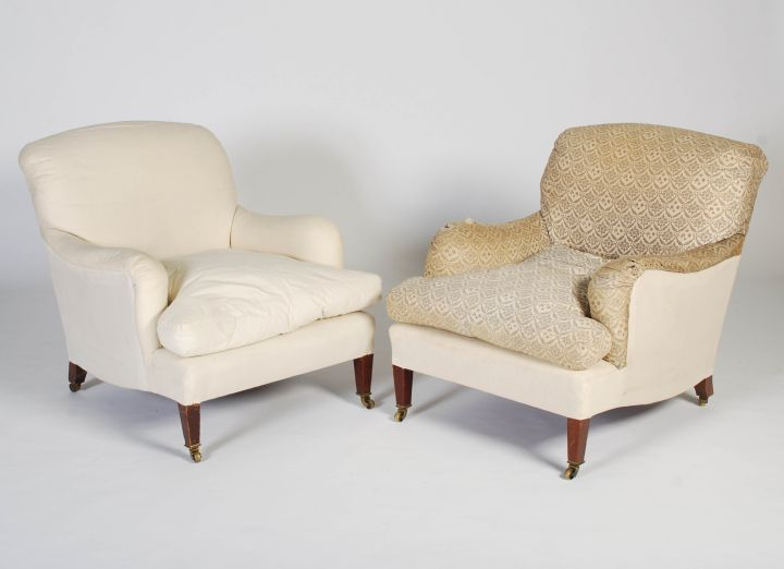 A pair of late 19th/early 20th century mahogany armchairs by Howard & Sons. Sold for £7100