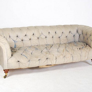 A Howard and Sons walnut Chesterfield sofa, sold for £8,100