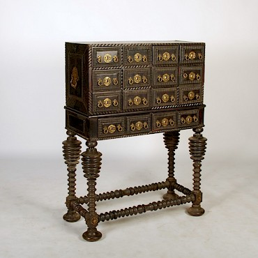 A late 17th century Portuguese ebony and gilt metal mounted Contador, sold for £2,500