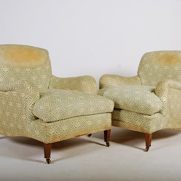 A pair of Howard and Sons mahogany armchairs, sold for £7,100