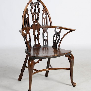 An 18th century yew, elm and ash Gothic Windsor Armchair, Thames Valley, sold for £4,300