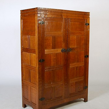 An oak cupboard by Robert