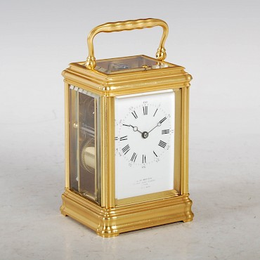 A late 19th century gilt brass repeating carriage clock, J. W. Benson, 25 Old Bond Street, London, sold for £850