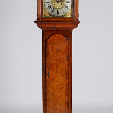 An 18th century Irish walnut, burr walnut, ebony and boxwood lined longcase clock, Paul Pineau, Dublin, sold for £7,500