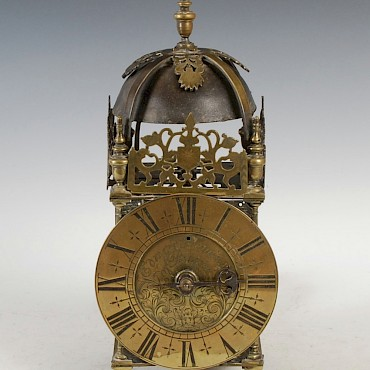 An 18th century lantern clock, Edward Hemins, Bister, sold for £4,800