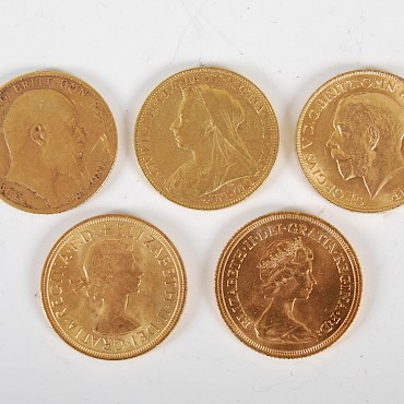 A collection of five Victorian and later gold Sovereigns, sold for £1,100