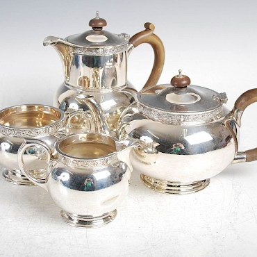 An Edwadian four piece silver tea set, sold for £500