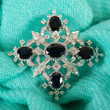 A 20th century white metal sapphire and diamond brooch, sold for £1,350