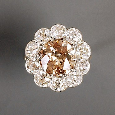 An Edwardian coloured diamond cluster ring, 5.48cts