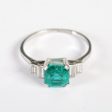 An emerald and diamond dress ring, sold for £1,300