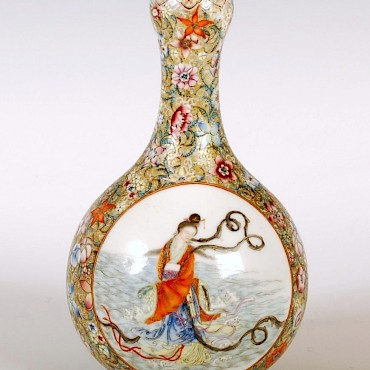 A Chinese porcelain bottle vase, bearing Yongzheng mark, sold for £3,500