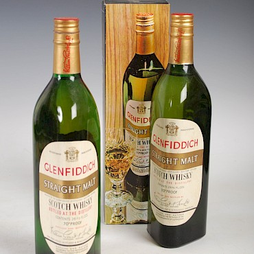 Two bottles of Glenfiddich Straight Malt Scotch Whisky, the first version of the iconic triangular shaped bottle, sold for £900