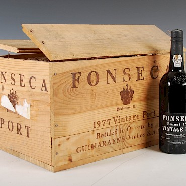 A case of eleven bottles of Fonseca Vintage Port, 1977, sold for £720