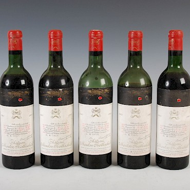 Five bottles of Chateau Mouton Rothschild, Pauillac, 1961, sold for £820