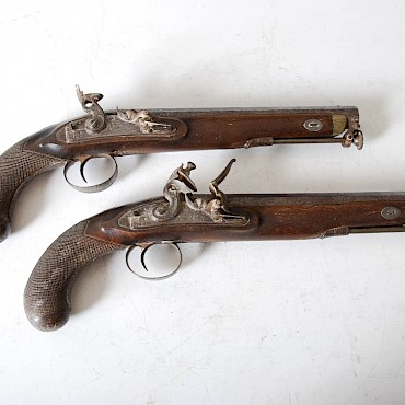 A pair of early 19th century flint lock pistols, Hawkes Moseley & Co., London, sold for £1,000