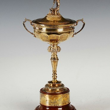 A replica silver gilt Ryder Cup trophy and cover, sold for £3,300