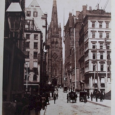 A of Wall Street, New York, 1887, from a late 19th century photograph album documenting a tour of New Zealand, Honolulu, The United States of America and Canada, sold for £2,250