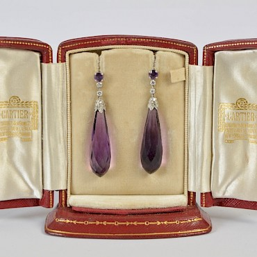 Featured lot 433. A pair of early 20th century amethyst and diamond earrings by Cartier, £3,000-5,000
