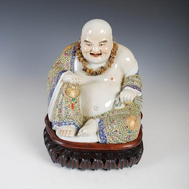 Lot 346. A Chinese porcelain figure of a laughing Buddha, late 19th/ early 20th century, sold for £12,500