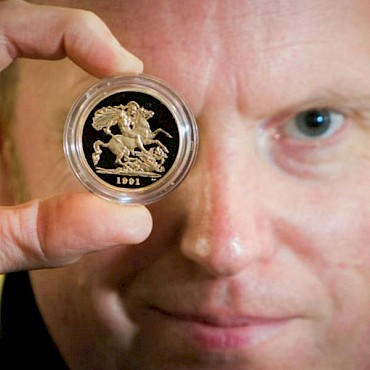 Golden eye: Auctioneer Nick Burns with one of the gold coins