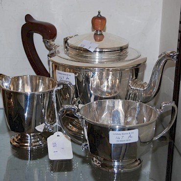Lot 147. A Birmingham silver three piece tea set, sold for £310
