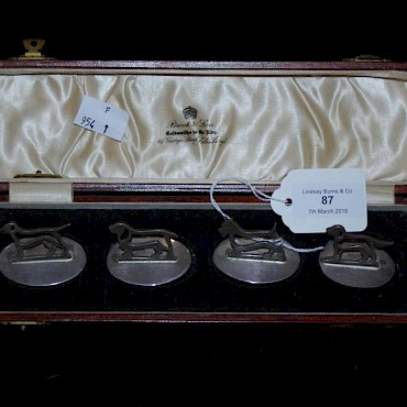 Lot 87. A cased set of four Edinburgh silver menu card holders each in the form of a different dog, sold for £290
