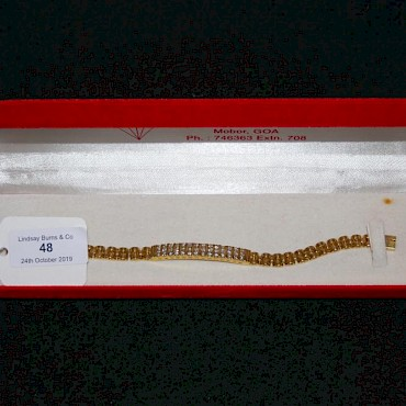 Lot 48. Yellow metal and diamond panel bracelet stamped 18K, sold for £650