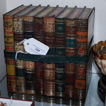 Lot 169. A Vintage Huntley & Palmers biscuit tin in the form of a stack of books, sold for £85