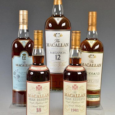 From a good private collection of whisky in the sale, clockwise from top, Lot 333, sold for £100, Lot 337, sold for £500, Lot 339, sold for £1,900, lot 340, sold for £1,900, & Lot 338 sold for £2,000.