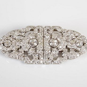 Lot 295. An Art Deco white metal and diamond set double clip brooch, approximately 11.85ct, £2,000-3,000, sold for £2,600