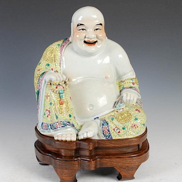 Lot 424. A Chinese porcelain figure of a laughing buddha, £800-1,200, sold for £5,500
